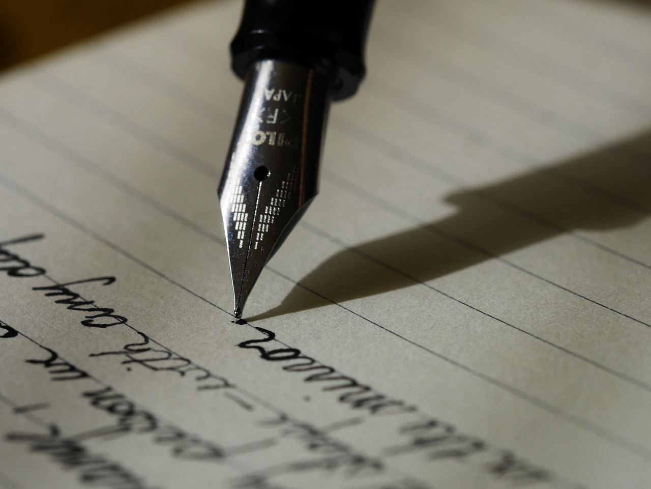 Photo of a fountain pen and writing