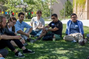 This is a picture of UCSB MAP Chapter Members sitting on the ground as part of a discussion circle at the Spring 2015 SoCal Regional Meeting at Irvine. Pictured from left to right: Daniel Story, Corey McGrath, Arnel Blake Batoon