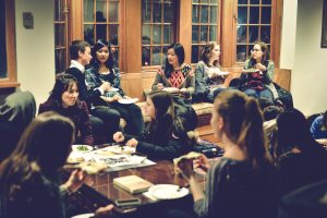 Undergraduates and graduate student participants enjoying an informal pizza dinner in the Philosophy Department lounge at Princeton.