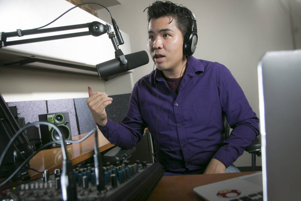 Photo of Barry Lam podcasting